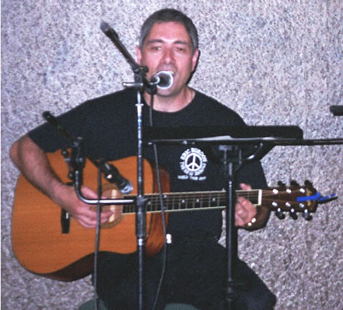 "Tony Palmeri sings and plays Neil Young's ""Rockin in the Free World"""